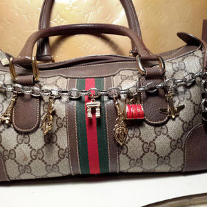 RESERVED for Kristi. Bag charm w 14k emblem